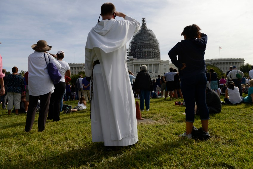 People watch Pope Francis address Congress from the West Front Lawn of the Capitol building in Washington, D.C. on Thursday.