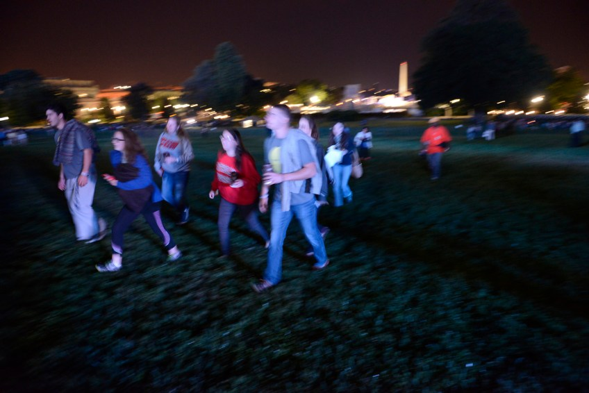 Before dawn, people hustle up the West Front Lawn to get spots close to the Capitol building before Pope Francis' address to Congress during his visit to Washington, D.C. on Thursday.