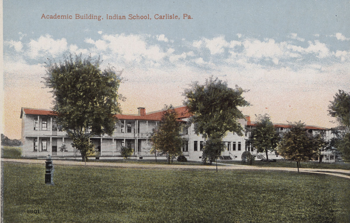 Postcard of Carlisle Indian School academic building.