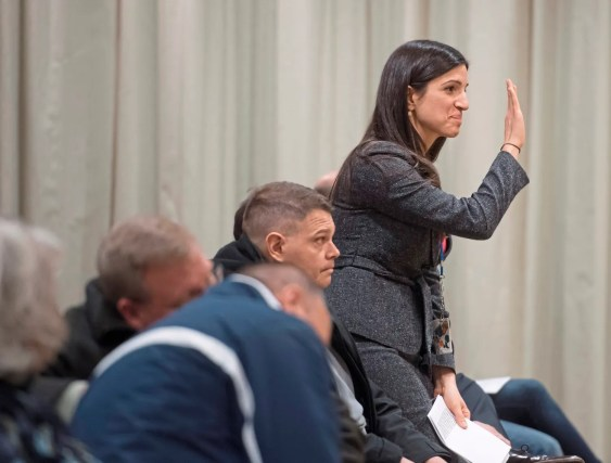 Hampton High School principal Marguerite Imbarlina waves to attendees during the Hampton Community Opioid Partnership roundtable event on Thursday, Jan. 18, 2018, at the Hampton Community Center. (Steph Chambers/Post-Gazette)
