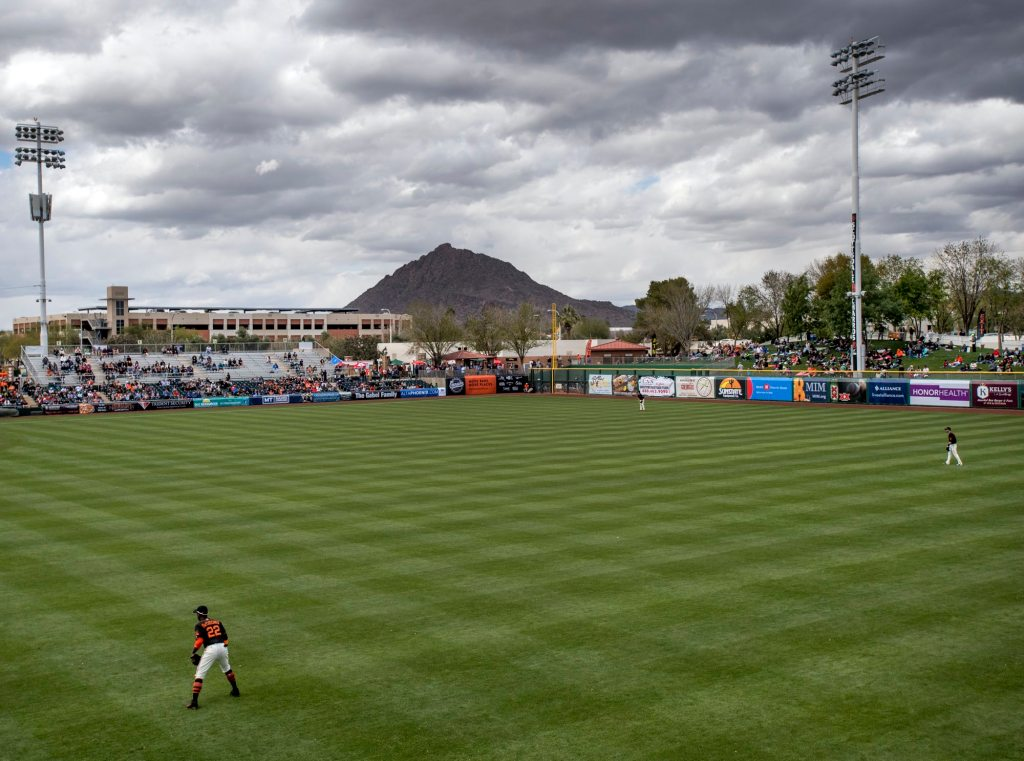 Andrew McCutchen mans right field during his first spring training game with the Giants. (Steph Chambers/Post-Gazette)