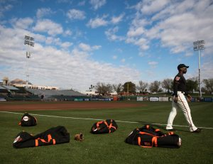 Andrew McCutchen prepares to warm up after putting his bag down. (Steph Chambers/Post-Gazette)