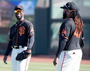 Andrew McCutchen laughs with pitcher Johnny Cueto. (Steph Chambers/Post-Gazette)
