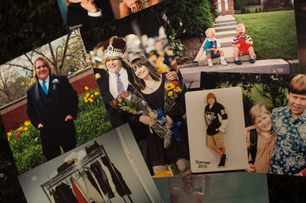 A photo of Spenser Flowers as homecoming king at Hampton Township High School in 2014 is surrounded by other photos from his life at his parents' home. (Stephanie Strasburg/Post-Gazette)