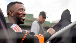 Andrew McCutchen watches from the dugout during his first spring training game with the San Francisco Giants on Friday, Feb. 23 in Scottsdale, Ariz. (Steph Chambers/Post-Gazette)
