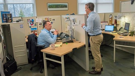 Joe Johnston, left, vice president and Frank Ily, director of business development of Tops Staffing and Resource Group, meet at their office in Plum. (Lake Fong/Post-Gazette)