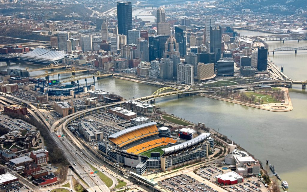 An aerial view of the  downtown skyline as a background to PNC Park and Heinz Field, Tuesday April 10, 2018 in Pittsburgh. (Darrell Sapp/Post-Gazette)