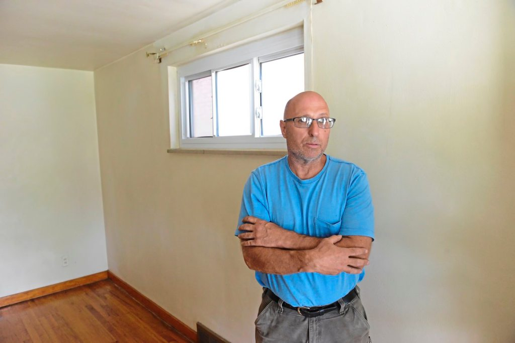 Dave Cunningham, 60, stands in one of his 80 rental units in Hazelwood. (Lake Fong/Post-Gazette)