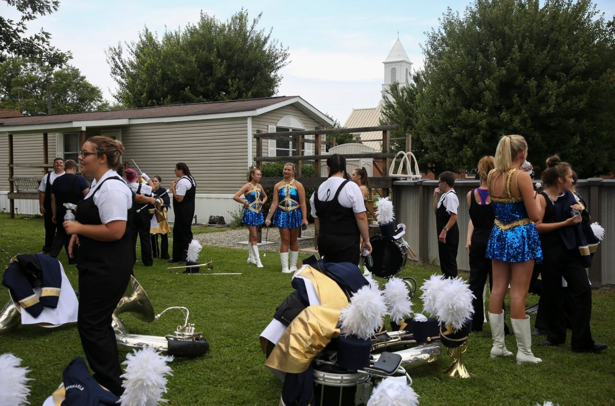 Members of the Carmichaels Area Senior High School marching band wait for the start of 65th Annual King Coal Parade on Aug. 25. The parade was founded to honor the legacy of the coal mining industry. (Jessie Wardarski/Post-Gazette)