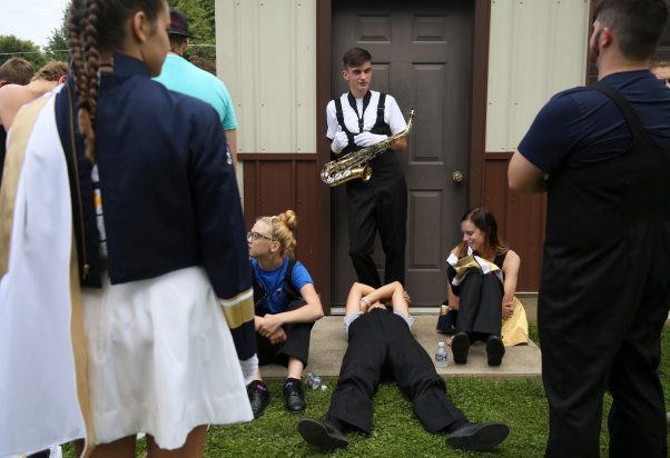 From left Emma Cap, Zach Hillsman, Delaney Lohr and Blanee Fabean of the Carmichaels Area Senior High School marching band wait for the start of the parade. (Jessie Wardarski/Post-Gazette)
