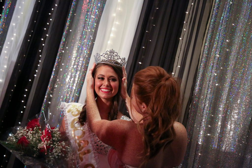 Holly Lesko, 17, left, a senior at Albert Gallatin High School, stands on stage with her dance teacher, Ariel Laight of Uniontown, after Lesko being crowned the 65th Bituminous Coal Queen on Aug. 19. (Jessie Wardarski/Post-Gazette)