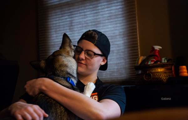 "Colby Love, 18, hugs his dog Luna after letting her back into the house, Wednesday, Feb. 6, 2019, at his home in Bethel Park. ""She was my reason for getting up a lot of the days,"" Love says, reflecting on a year ago when his depression, anxiety and overall mental health took a steep decline. ""Sometimes like, even when I let her outside and it's snowing and she's just like staring at the snow, or playing around in it, I'm just like, it's so pure and so adorable. Like how can you not love that,"" laughs Love."