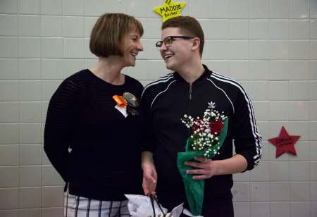 Kim Love, left, smiles back at her son Colby as they stand together on the pool deck after being announced at the Bethel Park swim team's senior night, Thursday, Feb. 7, 2019, at the high school in Bethel Park.