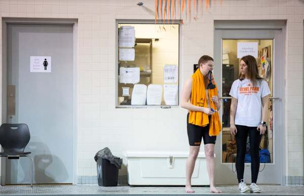 "Colby Love, left, 18, of Bethel Park holds his swim cap in his mouth as he stands on the pool deck with best friend and former Bethel Park swimmer Krista Wycinsky, 19, of California, Pa., before his next race, Thursday, Feb. 7, 2019, at Bethel Park High School in Bethel Park. A sophomore at California University of Pennsylvania, Wycinsky drove up to support long time friend, Love, on his senior night. ""Krista, who I still absolutely love,"" says Love, ""is just judgement-free all of the time,"" he says smiling."