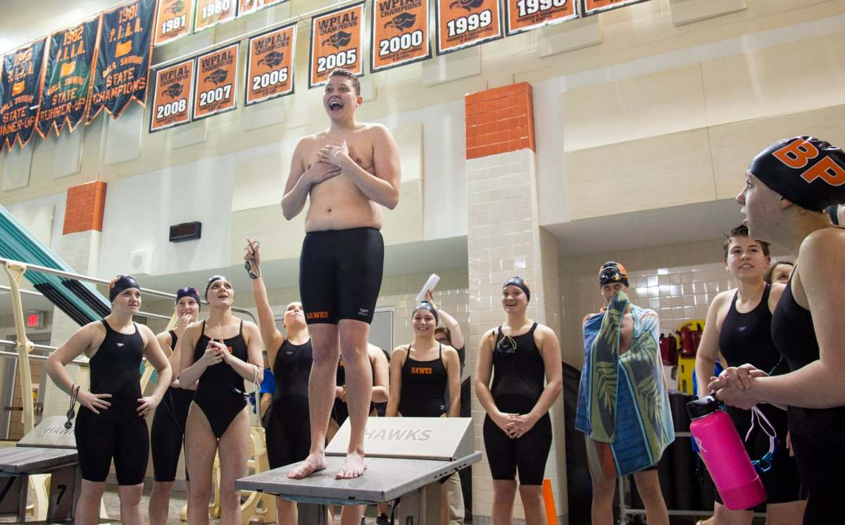 Colby, center, laughs as he's cheered on by his fellow Bethel Park swimmers on senior night, Thursday, Feb. 7, 2019, at Bethel Park High School. It's tradition that all senior swimmers belly flop off the block on senior night. Love did a cannonball instead.