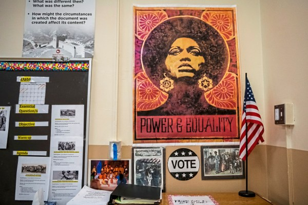 Posters and photos depicting scenes from African American history adorn a wall in Sharon Brentley's classroom, Friday, Feb. 15, 2019, at Perry High School. (Michael M. Santiago/Post-Gazette)