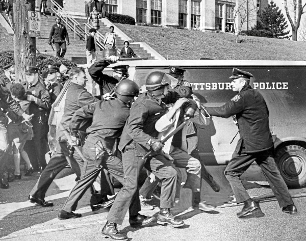 """Police wrestle Perry High student into submission following racial outbreak"" at the school, reads the caption on this photo from April 7, 1970. Dozens of students were detained. (Robert Pavuchak/Pittsburgh Press)"