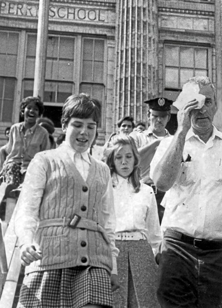George Arent, a city fire captain, leaves after he was injured in a fight between black and white students at Perry High School, Sept. 15, 1970. (Pittsburgh Press)