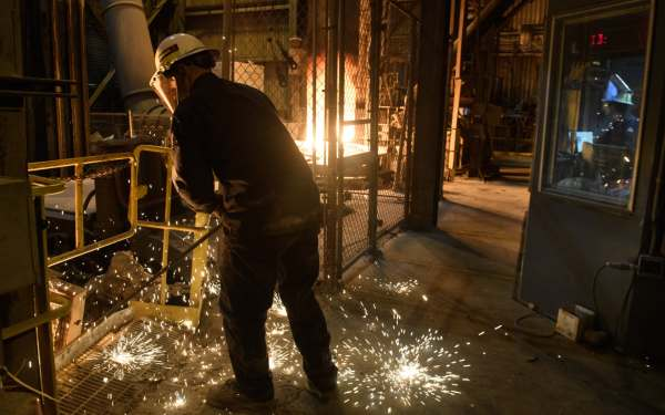 Sparks fly as Chad Brandon, 30, of Neffs, Ohio, dips into the ladle metallurgical furnace at the JSW Steel Ohio plant, in Mingo Junction, Ohio.