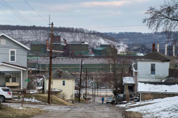 "Potholes run downhill towards the former Wheeling-Pittsburgh Steel facility, now purchased by JSW Steel, Wednesday, March 6, 2019, in Mingo Junction, Ohio. ""When the mill was closing down and they were knocking stuff down, they kept saying, 'It will never get opened back up,'"" said town resident Diane Pernick, 68. ""You just gotta have faith."""