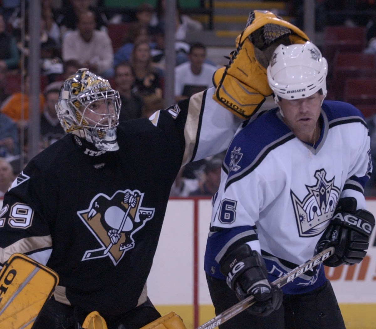 """After his debut as a rookie, Marc-Andre Fleury received a subtle nod from the visiting team, including Trent Klatt as seen here. """"The Kings came off the bench, and all of them to a man skated over to Fleury and tapped him on the pads,"""" Mike Lange said. """"It was an unbelievable moment."""""""