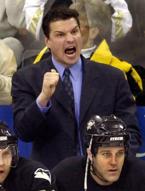 Penguins coach Eddie Olczyk is unhappy with a first-period penalty called on the Penguins during a game with the Nashville Predators on Thursday, March 4, 2004, at Mellon Arena. In foreground on bench is Pittsburgh's Mike Eastwood. (Gene J. Puskar/Associated Press)