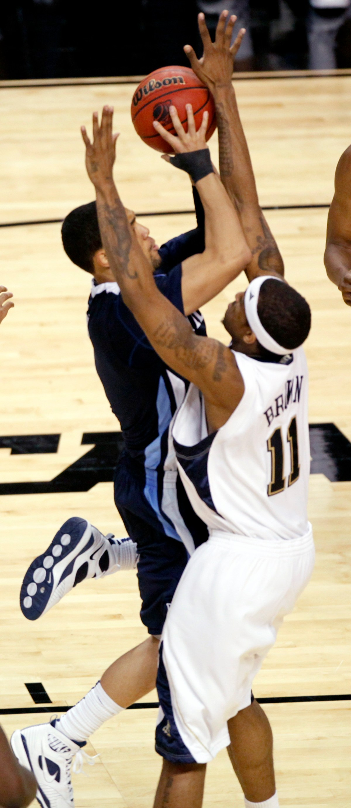 Villanova guard Scottie Reynolds (1) goes up for the winning basket against Pittsburgh's Gilbert Brown (11) in the second half during a men's NCAA tournament regional championship college basketball game in  Boston, Saturday, March 28, 2009. Villanova won 78-76 to advance to the Final Four. (AP Photo/Stephan Savoia)