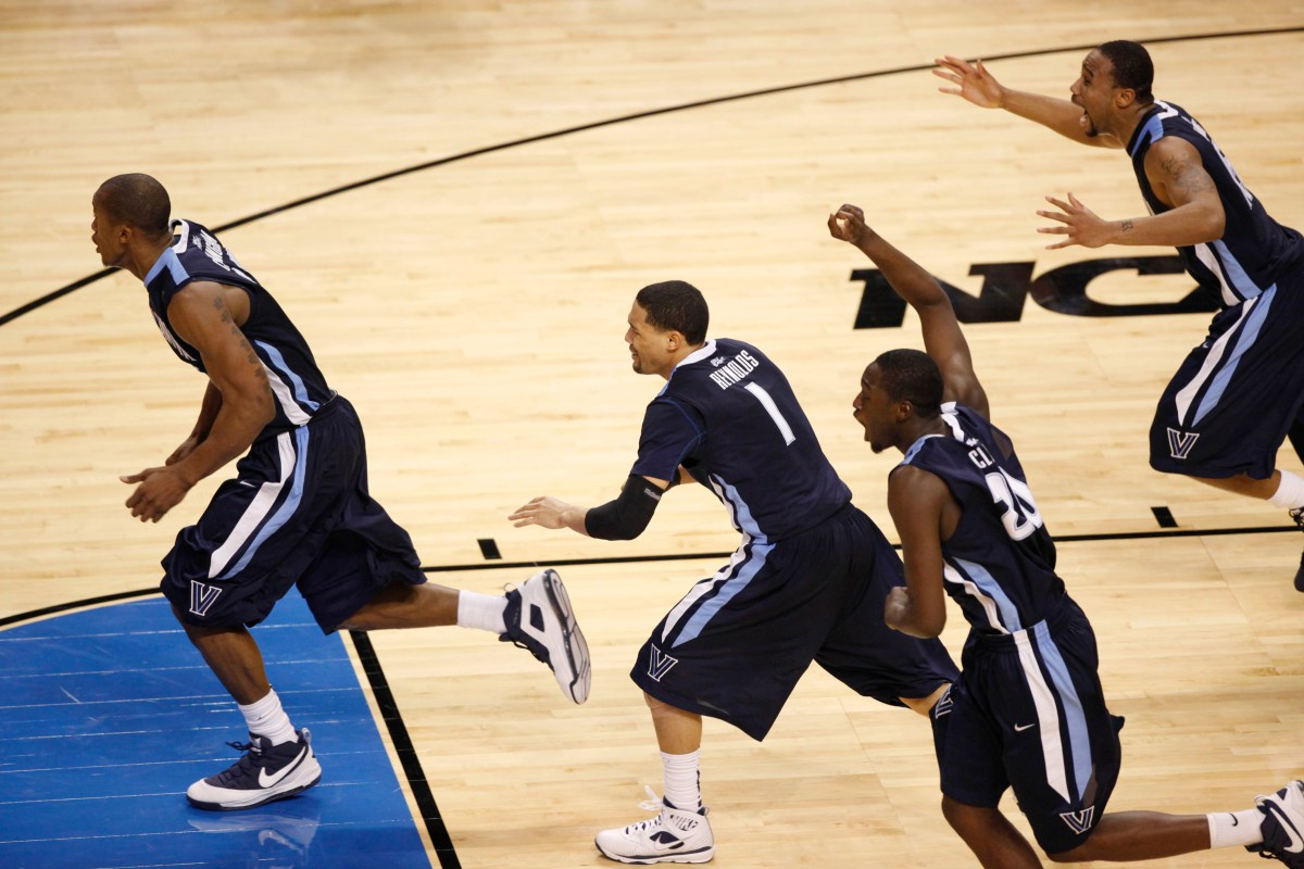 Villanova's Dante Cunningham, Scottie Reynolds (1), Shane Clark, second from right, and Reggie Redding celebrate Reynolds' game-winning shot, defeating Pittsburgh 78-76 during a men's NCAA tournament regional championship college basketball game in Boston, Saturday, March 28, 2009. Villanova advances to the Final Four. (AP Photo/Stephan Savoia)