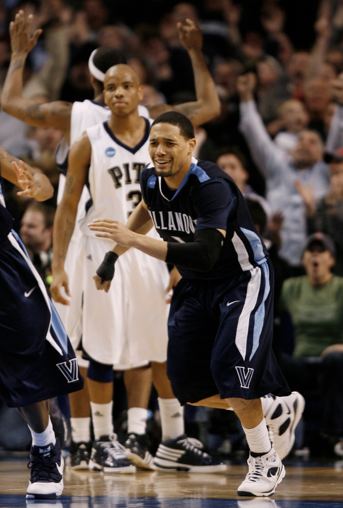 Villanova guard Scottie Reynolds (1) begins to celebrate his game-winning shot in front of Pittsburgh guard Jermaine Dixon (3) in the second half during a men's NCAA tournament regional championship college basketball game in Boston, Saturday, March 28, 2009. Villanova won 78-76 to advance to the Final Four. (AP Photo/Winslow Townson)