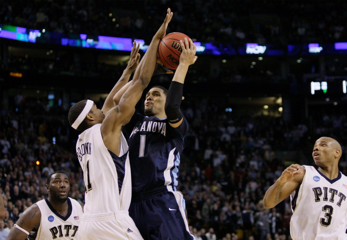 Villanova guard Scottie Reynolds (1) goes up for the winning basket against Pittsburgh's Gilbert Brown in the second half during a men's NCAA tournament regional championship college basketball game in Boston, Saturday, March 28, 2009. Villanova won 78-76 to advance to the Final Four. (AP Photo/Elise Amendola)
