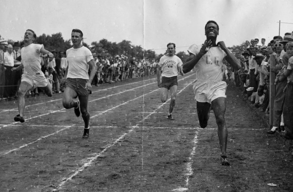 Herb Douglas Jr. winning the 100-yard dash at track meet. July 1946. (Courtesy of Heinz History Center)