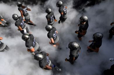 Pitt enters the field to take on Louisville at Heinz Field, Saturday, Sept. 26, 2020, on the North Shore. (Matt Freed/Post-Gazette)
