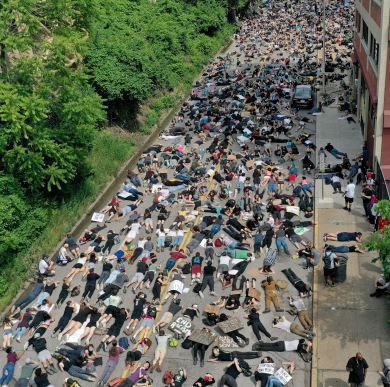 Protesters stage a lay-in across Second Avenue by the Allegheny County Jail, Thursday, June 4, 2020, in Uptown. An estimated 1,000 people had walked miles and for nearly four hours to protest police brutality, racism and social injustice in the wake of the death of George Floyd, a Minneapolis man who died while in police custody. (Matt Freed/Post-Gazette)