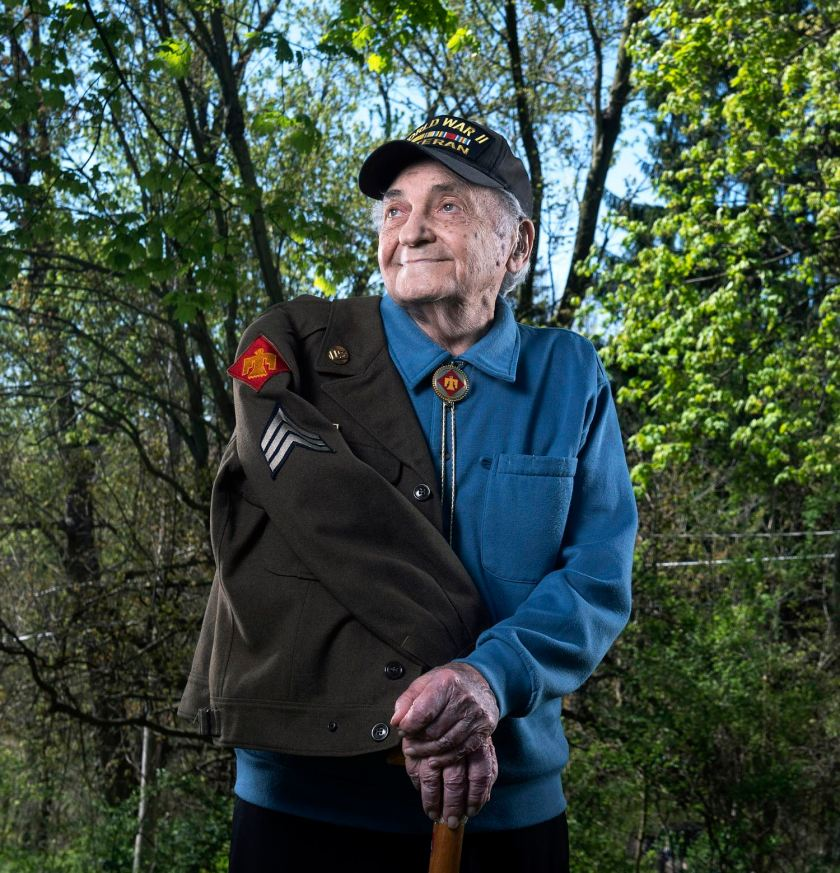 World War II veteran Guy Prestia, 98, poses for a portrait Thursday, May 7, 2020, at his home in North Sewickley Township. Mr. Prestia, a sergeant who manned a Browning automatic rifle, saw heavy combat and his division suffered 63,000 casualties. At the end of the war, his division liberated Dachau, the first concentration camp established by the Nazi regime, on April 29, 1945. (Nate Guidry/Post-Gazette)