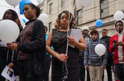 Dontesha Rouse, center, awaits a balloon release after a funeral for her brother, Christian Moore-Rouse, Wednesday, March 11, 2020, at Mulberry Community Church in Wilkinsburg. Police found Mr. Moore-Rouse's remains in a wooded area near Settlers Ridge Road in Fox Chapel. At left is Khadiyjah Cook, fiancée of Michael Rouse, brother of Christian, and Ms. Cook's sister Sojourner Cook. (Steve Mellon/Post-Gazette)