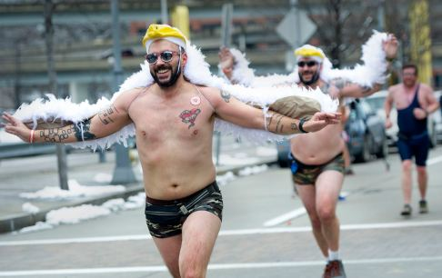 "James Stiffey, 40, from Hopewell, leads his twin brother Timothy, right, from Cecil, to the finish line in the Cupid's Undie Run, Saturday, Feb. 8, 2020, on the North Shore. The charity run, billed as ""the largest pantless party and mileish run for charity,"" is run to raise awareness of neurofibromatosis, a genetic disorder and fundraises for NF research through the Children's Tumor Foundation. Over 600 runners participated raising close to $120,000 for the charity. (Pam Panchak/Post-Gazette)"