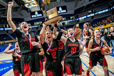 The Mohawk girls high school basketball team celebrates after they defeat Beaver 44-26 to win their first WPIAL Class 3A championship, Saturday, Feb. 29, 2020, at Petersen Events Center in Oakland. (Michael M. Santiago/Post-Gazette)