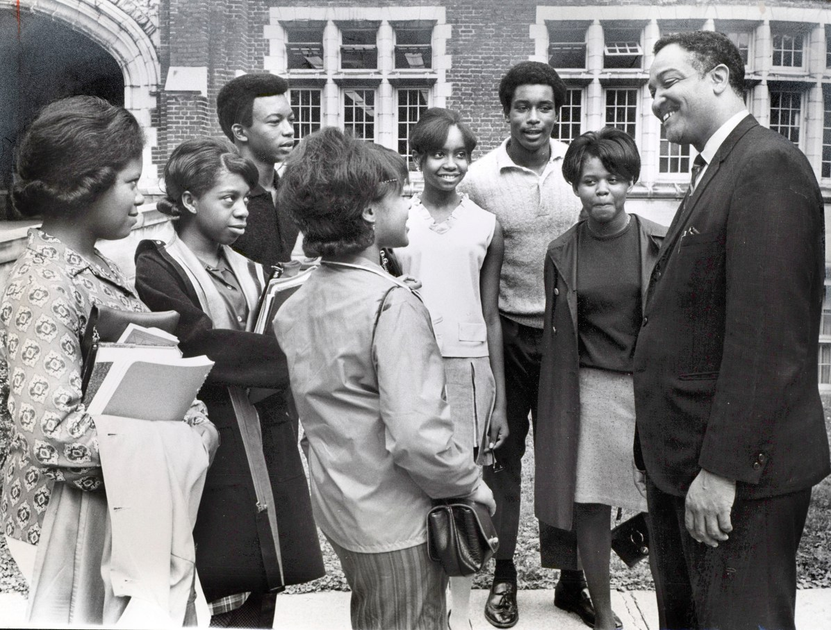Flute Rice is named principal of Scott High School. He was the first black principal in Scott history. From left to right, Cynthia Williams, Peggy Davis, Kenny Richardson, Denise Johnson, Christine Walsh, Erick Barbour, Gloria Johnson and Rice. Blade file photo 1968