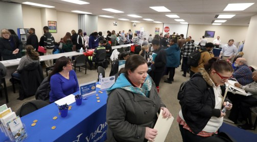 Kathryn Hopkins, of Toledo, waits to hand in her application for employment at The Courtyard by Marriott during a busy OhioMeansJobs Lucas County job fair in Toledo on Friday, March 15, 2019. THE BLADE/AMY E. VOIGT CTY automation15