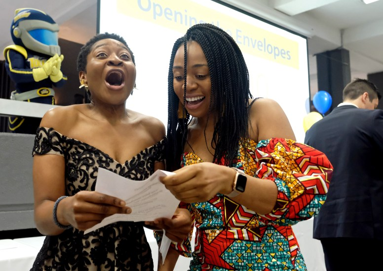 Vanessa Ngea (cq), left, celebrates with her cousin Sonita Tem (cq) after finding out Sonita was accepted into the radiology-diagnostic residency at the Indiana University School of Medicine and internal medicine residency at Case Western/University Hospitals Cleveland Medical Center during the Match Day event in which fourth-year University of Toledo medical students find out their residency placements at the Stranahan Theater and Great Hall on Friday, March 15, 2019. THE BLADE/KURT STEISS CTY match16p