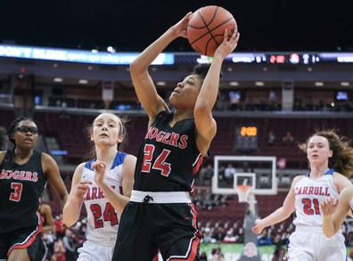 Rogers' Cortnney Gardner (24) shoots against Dayton Carroll's Allie Stefanek (24) during a girls Division II State Championship basketball game Saturday, March 16, 2019, at the Jerome Schottenstein Center in Columbus, Ohio. THE BLADE/JEREMY WADSWORTH SPT D2stateGBK17