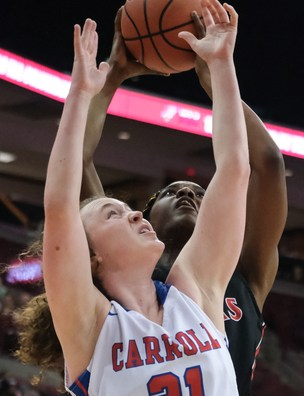 Rogers' Tanaziah Hines (35) shoots against Dayton Carroll's Elisabeth Bush (21) during a girls Division II State Championship basketball game Saturday, March 16, 2019, at the Jerome Schottenstein Center in Columbus, Ohio. THE BLADE/JEREMY WADSWORTH SPT D2stateGBK17