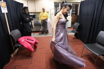 Shakira Sweeney, 20, twirls as she shows off a dress during the Once Upon a Formal - Outfit Selection event at the West Toledo Branch Library in Toledo, Ohio on Tuesday April 16, 2019. The West Toledo Branch Library held the Once Upon a Formal - Outfit Selection giving away 900 prom dresses and accessories. THE BLADE/REBECCA BENSON CTY PROMDRESS17