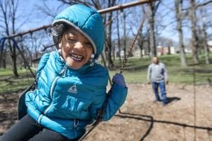 "TaNeisha ""Mammas"" Wilson, 6, laughs as she swings at Ottawa Park in Toledo, Ohio on Monday April 15, 2019. THE BLADE/REBECCA BENSON CTY Rover"
