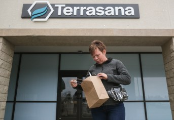 Beth Gonzales of Clyde leaves Terrasana Labs, a medical marijuana dispensary, with her prescription filled Wednesday, April 17, 2019, in Fremont, Ohio. THE BLADE/JEREMY WADSWORTH CTY marijuana18p