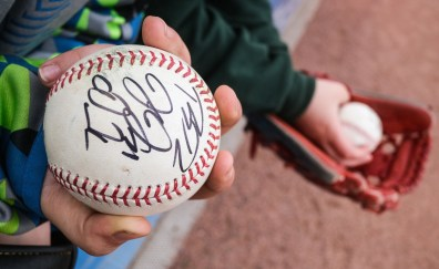 Jacob LaLonde, 9, of Oak Harbor, Ohio, tries to get autographs from Toledo Mud Hens baseball players Wednesday, April 10, 2019, at Fifth Third Field in Toledo, Ohio. THE BLADE/JEREMY WADSWORTH SPT Hens11
