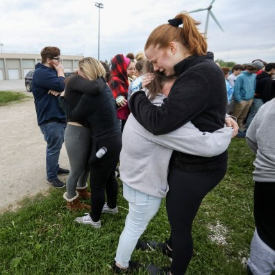 Kelsey Rigsby, 15, right, hugs Elizabeth Hanley, 15, as they cry together during a vigil for Majestic Karcsak at Clay High School in Oregon, Ohio on Monday May 20, 2019. Karcsak was killed in a fatal car crash last Thursday. THE BLADE/REBECCA BENSON