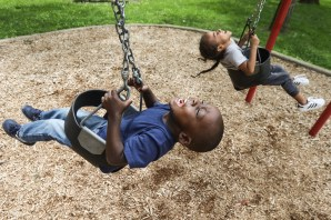 Keeth Brown, 3, left, and David Johnson, 5, yell as they spin in circles on the swings at Close Park in Toledo, Ohio on Friday June 14, 2019. THE BLADE/REBECCA BENSON