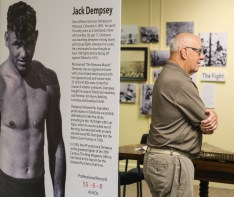 Bob Wuest of Toledo looks through an exhibit about the Jess Willard vs. Jack Dempsey fight Thursday, June 20, 2019, at the Toledo History Museum in Toledo, Ohio. THE BLADE/JEREMY WADSWORTH