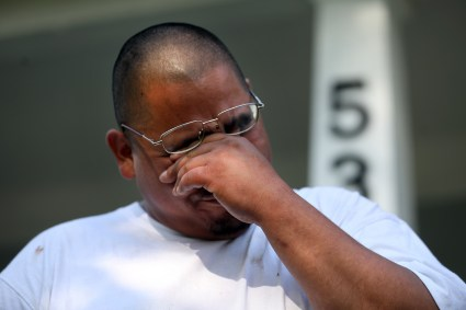 Michael Vasquez, father of Celina Vasquez, 2, cries while he talks about his daughter being accidentally run over and killed in front of his home on the 500 block of Toronto Ave. last night. THE BLADE/AMY E. VOIGT